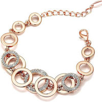 Sukkhi Resplendent Twisted Round Crystal Pink Gold Plated Bracelet
