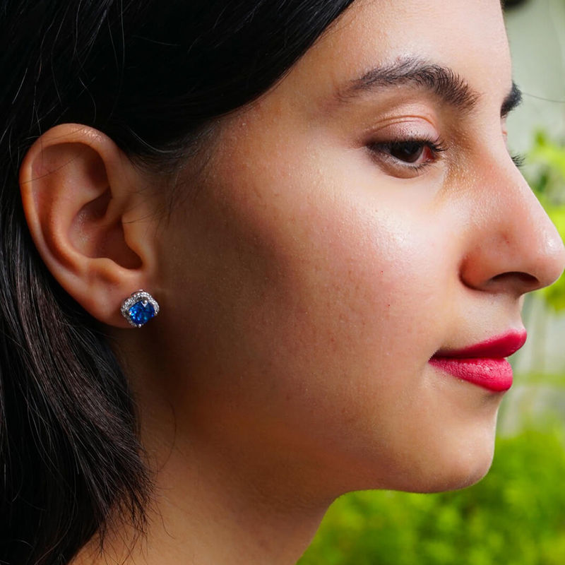 Ornate Jewels Blue Sapphire Halo Studs In 925 Silver