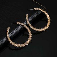 Ferosh Nicasia Golden Confetti Hoop Earrings